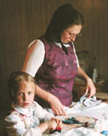 AmishQuilter - Photograph used with permission of the Germans from Russia Heritage Collection, North Dakota State University Libraries, Fargo www.lib.ndsu.nodak.edu/grhc