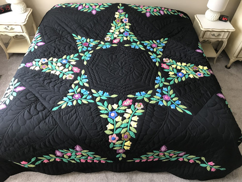 Black Amish Quilt with a Stunning Flower Star Pattern