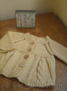 knitting pattern photo of #66 Beautiful Cabled Baby Jacket Knitting Pattern