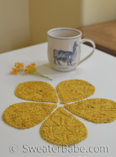 hibiscus coasters in fingering-weight yarn