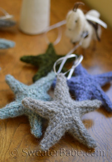 puffy stars - grey in front, green middle, periwinkle in back