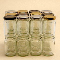 105ml glass  jam jar. Supplied with a heat sealable lid in 3 different colours.