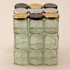 45ml  Hexagonal  jam jars with heat sealable lids in a choice of 3 colours. This miniature jam jar is perfect for wedding favours.