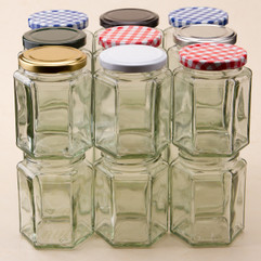 283ml Hexagonal Glass Jam Jar. This faceted jar is supplied with a twist off heat sealable lid in a choice of 7 different colours.