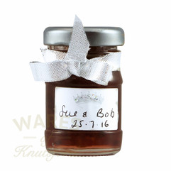 50ml mini  glass jam jars. Clear glass jar supplied  with a twist - off  lid. Perfect for wedding favours .
