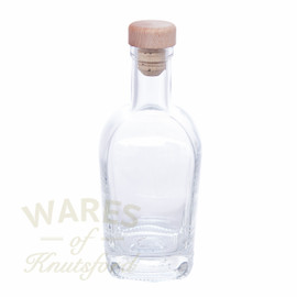 A luxury heavyweight glass bottle with a cork. The cork is either a  wooden topped mushroom or tapered.