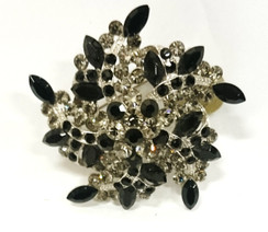 Black and clear diamontie swirl brooch