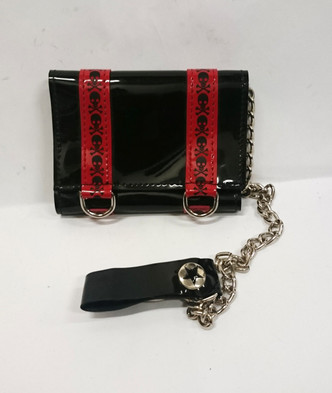 Vinyl wallet with red skull and cross bone detail and chain