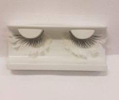 Black lashes with white feather extensions