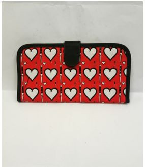 Red card holder wallet with white hearts and daggers print
