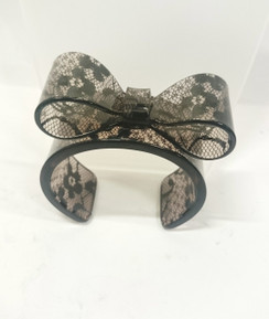 Black polka dot print hard plastic bow cuff