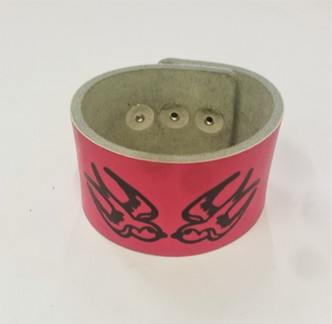 Pink cuff with black swallows print