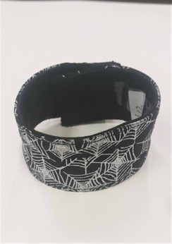 Black Fabric cuff with white webs