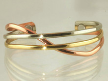 The Copper Swirl magnetic copper bracelet is inspired by the fire dancing performance at Burning Man, probably the largest gathering of creative people happening at the end of each Summer in the Nevada desert.