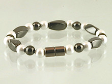 Magnetic bracelet made with triple strength twist and round beads of pearlized and black magnetic hematite