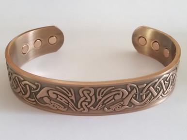 The Celtic Bird copper bracelet for men has a beautiful embossed celtic design