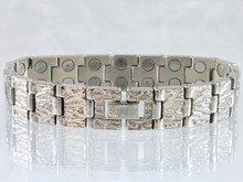 "This bracelet has a 9/16"" wide x 3/8"" long link with 38 rare earth magnets in 8 5/8"" length. It has a magnetic therapy pull strength of 1300 grams."
