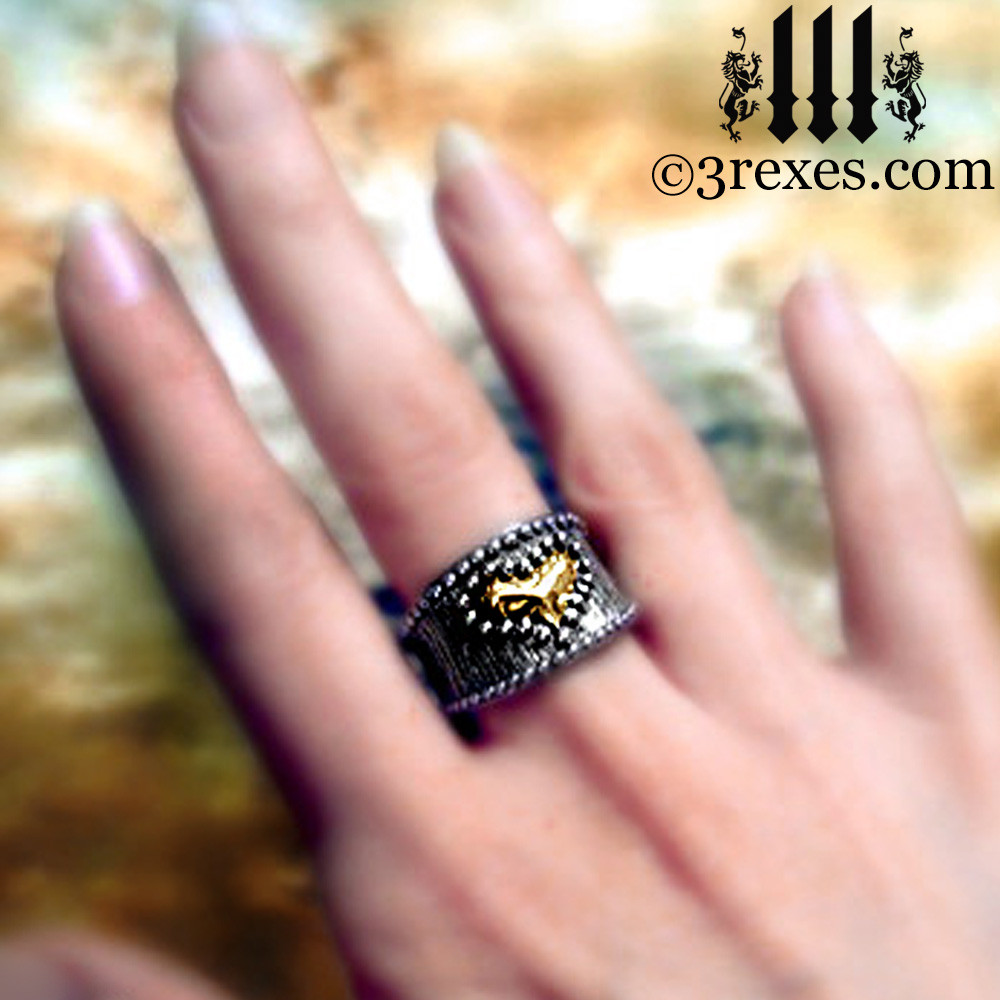 medieval studded gold heart ring on middle finger