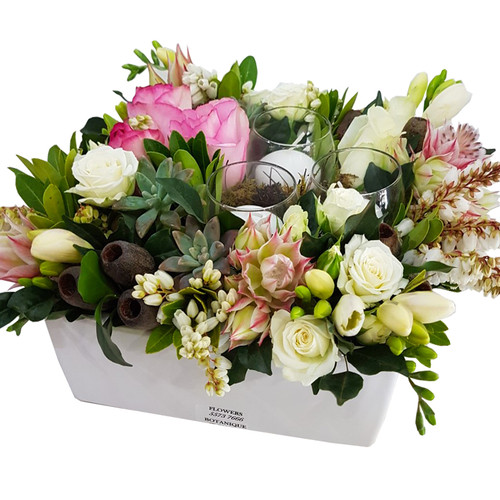 Emma Arrangement of roses, freesias, succulents, candles, native foliages, nuts and berries.