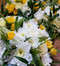 yellow and white mix of roses and seasonal flowers