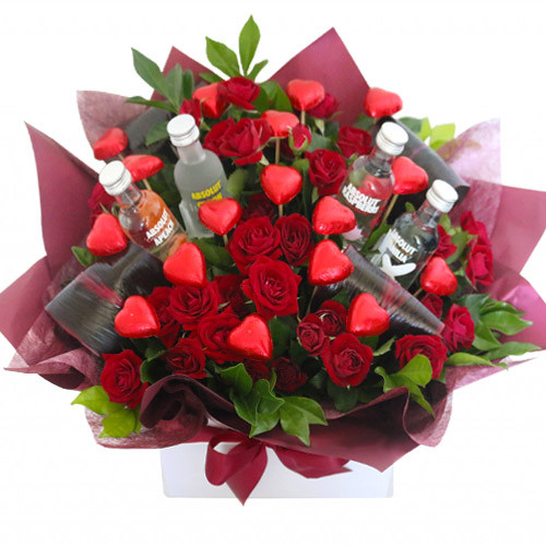 Absolut Vodka with mini roses and heart chocolates