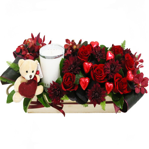Hugs and Kisses - soy candle, teddy, chocolates, roses and other seasonal flowers in a wooden box