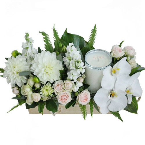Addie - Arrangement of Phalaenopsis orchids, spray roses, stock, dahlias and a candle in a wooden box