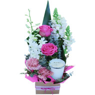 Jody arrangement of flowers with a candle