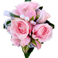 Pink spray roses in corsage