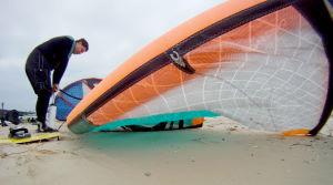 Jake pumping up a larger kiteboarding kite