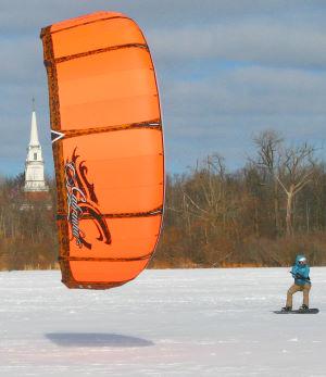 Snowkiting with a Cabrinha kiteboarding kite.