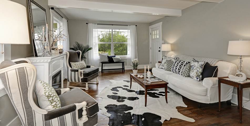 Classic wingback  chairs,light  decor &  lamps  with  cowhide brown shown on ground