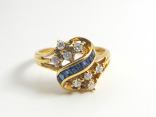 14 Karat Yellow Gold Sapphire and Diamond Ribbon Ring