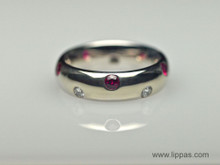 18 Karat White Gold Ruby and Diamond Flush Set Band