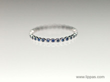 18 Karat White Gold Bezel Set Thin Sapphire Band