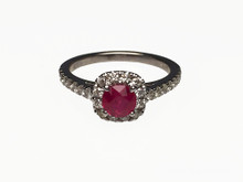 14 Karat White Gold Ruby and Diamond Halo ring