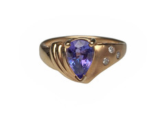 14 Karat Yellow Gold Pear Shaped Tanzanite and Diamond Ring