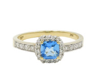 14 Karat Yellow Gold Cushion Cut Blue Topaz and Diamond Halo Style Ring