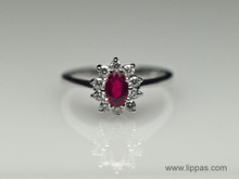 14 Karat White Gold Oval Ruby and Diamond Cluster Ring