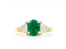 14 Karat Yellow and White Gold Emerald and Trillion Cut Diamond Ring