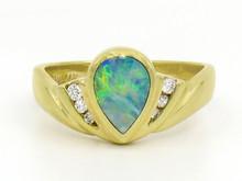 14 Karat Yellow Gold Pear Shaped Opal and Diamond Ring