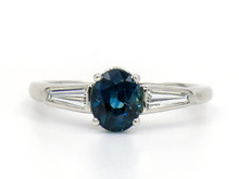 14 Karat White Gold Oval Sapphire Ring with Tapered Baguettes