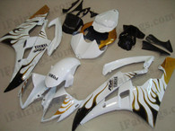 Yamaha YZF-R6 2006 2007 white and gold flame fairing kits, this Yamaha YZF-R6 2006 2007 plastics was applied in white and gold flamegraphics, this 2006 2007 YZF-R6 fairing set comes with the both color and decals shown as the photo.If you want to do custom fairings for YZF-R6 2006 2007,our talented airbrusher will custom it for you.