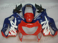 Honda CBR600 F4 1999 2000 red and blue fairing kits, 1999 2000 Honda CBR600 F4 red and blue plastic.This Honda CBR600 F4 1999 2000 fairing kits was applied in red and blue graphics, this 1999 2000 CBR600 fairing set comes with the both color and decals shown as the photo.If you want to do custom fairings for CBR600 F4 1999 2000,our talented airbrusher will custom it for you.