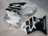 Honda CBR600 F4 1999 2000 white and black fairing kits, 1999 2000 Honda CBR600 F4 white and black plastic.This Honda CBR600 F4 1999 2000 fairing kits was applied in white and black graphics, this 1999 2000 CBR600 fairing set comes with the both color and decals shown as the photo.If you want to do custom fairings for CBR600 F4 1999 2000,our talented airbrusher will custom it for you.