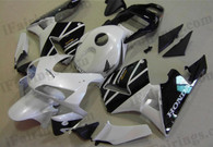 Honda CBR600RR 2003 2004 factory color white/black fairing kits, this Honda CBR600RR 2003 2004 plastics was applied in factory color white/black graphics, this 2003 2004 CBR600RR fairing set comes with the both color and decals shown as the photo.If you want to do custom fairings for CBR600RR 2003 2004,our talented airbrusher will custom it for you.