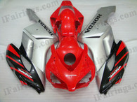 Honda CBR1000RR 2004 2005 red and silver fairing kits, this Honda CBR1000RR 2004 2005 plastics was applied in red and silvergraphics, this 2004 2005 CBR1000RR fairing set comes with the both color and decals shown as the photo.If you want to do custom fairings for CBR1000RR 2004 2005,our talented airbrusher will custom it for you.