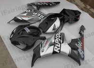 Honda CBR1000RR 2006 2007 Repsol black/silver fairing kits, this Honda CBR1000RR 2006 2007 plastics was applied in Repsol black/silvergraphics, this 2006 2007 CBR1000RR fairing set comes with the both color and decals shown as the photo.If you want to do custom fairings for CBR1000RR 2006 2007,our talented airbrusher will custom it for you.
