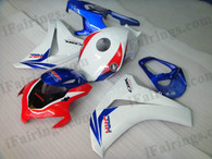 Honda CBR1000RR 2008 2009 2010 2011 red/blue/white fairing kits, this Honda CBR1000RR 2008 2009 2010 2011 plastics was applied in red/blue/whitegraphics, this 2008 2009 2010 2011 CBR1000RR fairing set comes with the both color and decals shown as the photo.If you want to do custom fairings for CBR1000RR 2008 2009 2010 2011,our talented airbrusher will custom it for you.