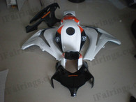 Honda CBR1000RR 2008 2009 2010 2011 white and black fairing kits, this Honda CBR1000RR 2008 2009 2010 2011 plastics was applied in white and blackgraphics, this 2008 2009 2010 2011 CBR1000RR fairing set comes with the both color and decals shown as the photo.If you want to do custom fairings for CBR1000RR 2008 2009 2010 2011,our talented airbrusher will custom it for you.